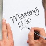 How often should we conduct a performance review meeting?